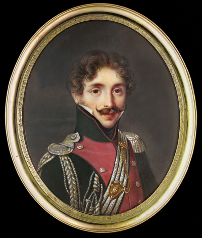 Portrait miniature of a Captain, wearing the uniform of the Régiment de Lanciers de la Garde Royale, circa 1816-30, his dark green and scarlet uniform with silver epaulette and shoulder strap ('contre-épaulette'), Louis Francois Aubry