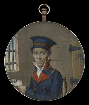 Portrait miniature of an Officer, wearing dark blue uniform with red collar and lapels, his dark blue hat with gold braid, seated in a prison cell, a letter in his left hand inscribed 'Paris/  20 9bre/ 1816',  French School