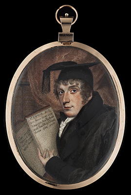 Portrait miniature of a Theologian (probably a Doctor of Divinity) in his study, wearing black robes and a black cap, he gestures to a bible open at the passage; 1 John 5:7,  English School