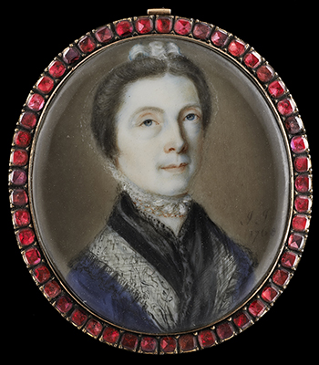 Portrait miniature of a Lady, wearing dark blue and white dress with black lace shawl, a white bonnet tied under her chin, John Smart