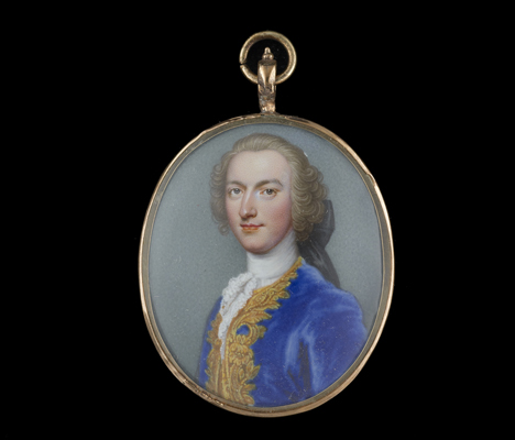 A portrait miniature enamel of Francis Beckford (d.1768) wearing blue coat embroidered with gold, tied with lace cravat, brown hair worn en queue, Christian Friedrich Zincke